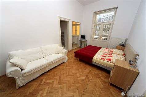 bed in living room apartment stare mesto dusni in prague