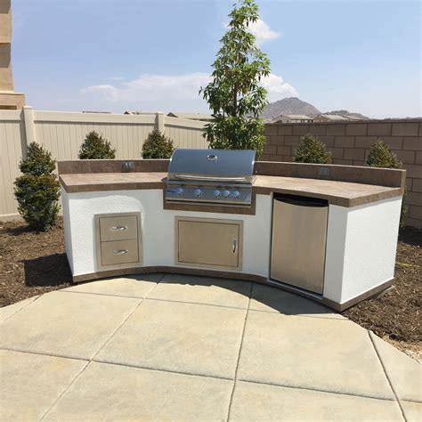 Kitchen Islands And Carts curved bbq island w tile top white stucco sides