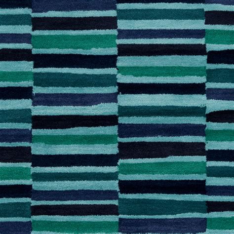 striped rug in navy and teal by surya