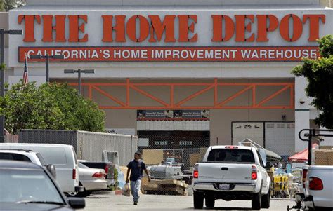 home depot boosts profit sales as housing market improves