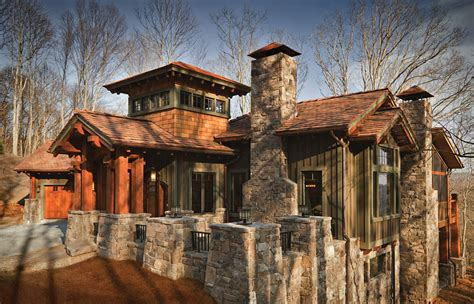 timbered entry  dramatic light filled tower kn architectural designs house plans