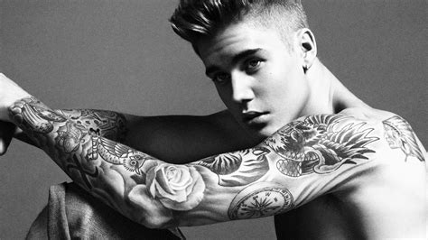 justin beiber tattoos justin bieber proud of all his tattoos samaja live