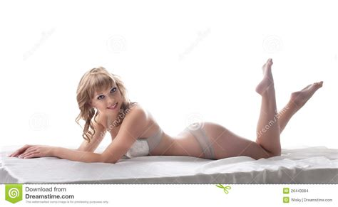 beauty girl lay and smile in bed sexy lingerie stock
