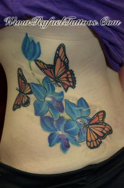 butterfly gun tattoo after the finished work by blue orchids and monarch butterflies by rafael marte tattoos