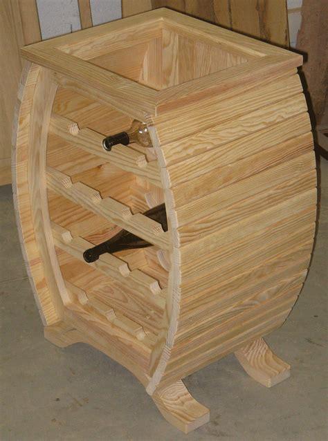 Superbe Assemblage Meuble Bois #1: 130_jconessa_meuble_bouteilles_tonneau-meuble-fini.png