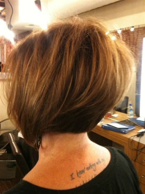 highlights with blonde and dark on chin length hair asymmetrical soft graduated bob with color and caramel