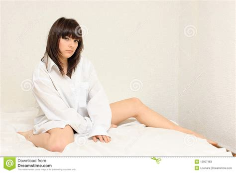 girl sitting on bed sexy girl sitting on her bed stock photos image 13007183