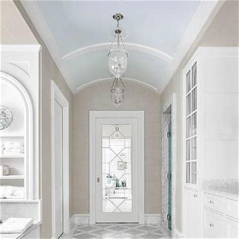 blue bathroom ceiling white and blue bathroom with arched tub alcove