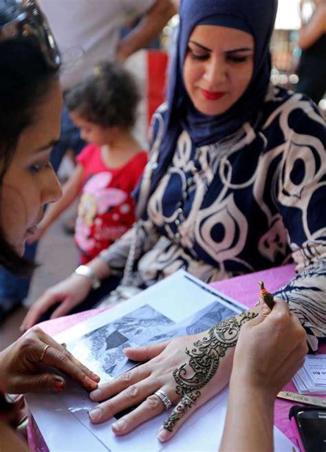 henna tattoo riverwalk san antonio thin crowd marks eid festival san antonio express news