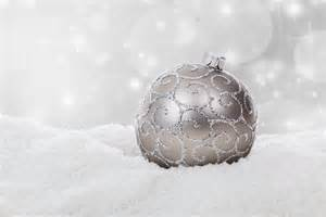 silver christmas ball in snow free stock photo public