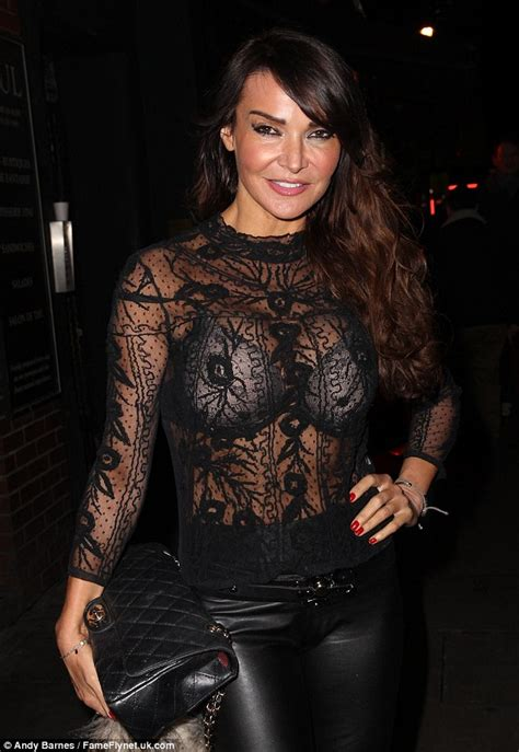 Glow Gamis By Gagah lizzie cundy flashes bra underneath sheer lace top as she