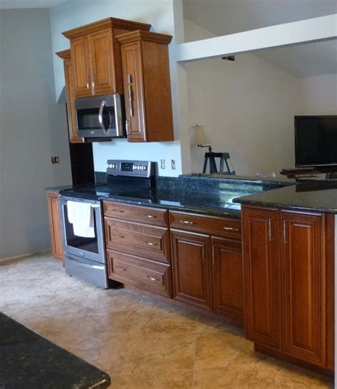 wall color   medium cherry cabinets