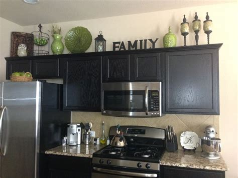 home decor decorating above the kitchen cabinets kitchen decor green black brown color