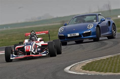 formula 4 car opposites attack porsche 911 turbo s vs f4 race car