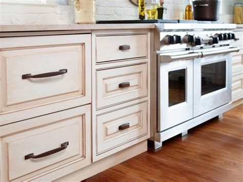 white kitchen cabinets with copper cup pulls and copper sink transitional kitchen amerock decorative cabinet and bath hardware 1853561
