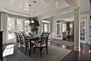 Dining Room Definition A Coffered Ceiling Large Windows And White Pillars Define The Sun Filled Dining Room Of The