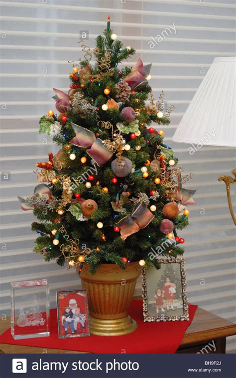 small decorated trees a small elegantly decorated tree sits atop a