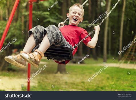 swinging with little boy swinging stock photo 125871449 shutterstock
