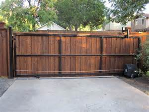 Rear view cedar board batten automatic sliding gate dallas by