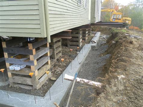 Cribbing Wood by Foundation Replacement Maine Coast Construction