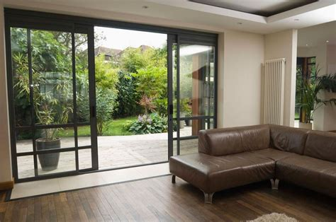 Sliding Glass Door Decor Decor Leather Sofa Design Ideas With Green Glass Door Plus Wooden Flooring For Living Room Decor