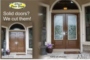 Double front entry doors with glass inserts in top portion of doors