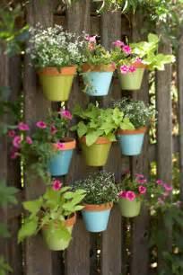 Vertical Garden Fence - diy colorful vertical garden on a fence shelterness