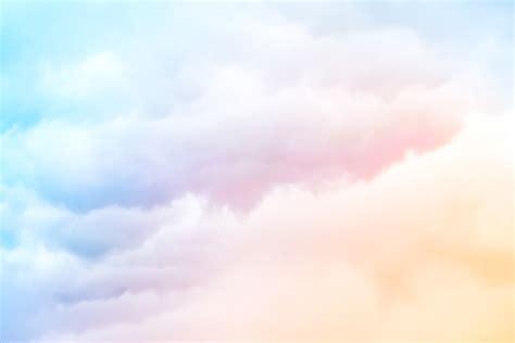 wallpaper biru soft a soft cloud background with an orange pastel blue