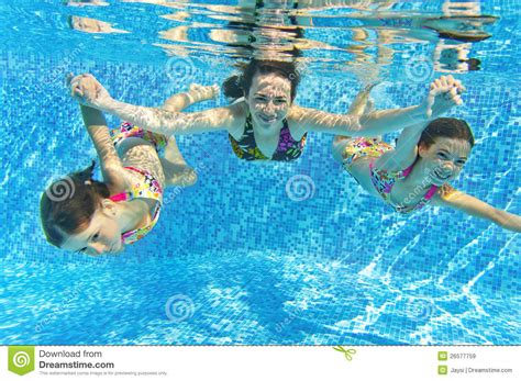 Family Swim Poll happy smiling family underwater in swimming pool royalty free stock photo cartoondealer