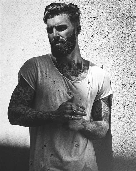 bearded tattooed man levi stocke black and white portrait beard and