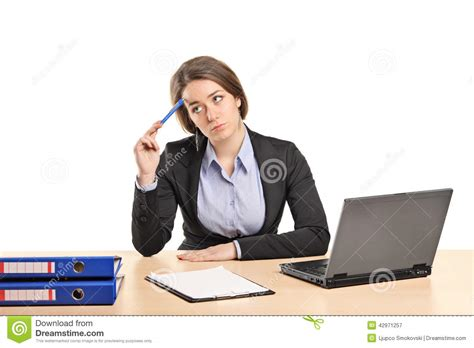 Sitting At Desk by Pensive Businesswoman Sitting At A Desk