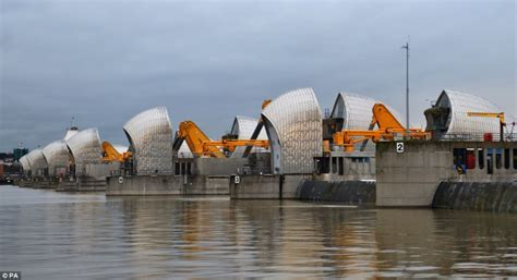 thames barrier burst evacuations underway as villages cut off by ferocious