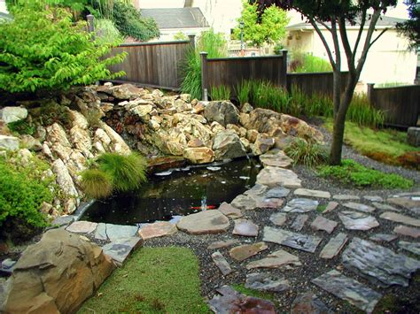 stone waterfalls backyard large backyard garden house design with koi ponds and