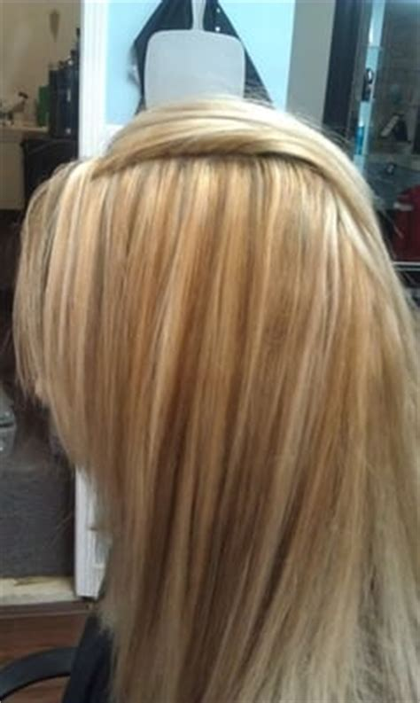 gallery of foiled hair blonde hair with highlights and darker shades added with