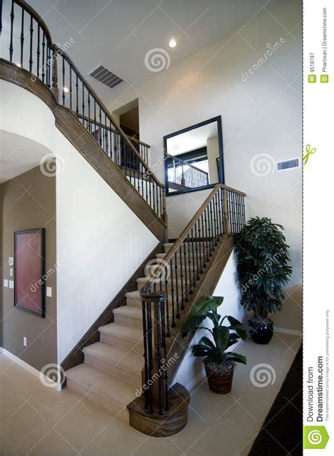 Contemporary Chair Rail - elegant stair case and wooden banister stock image image 9518787