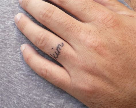 finger name tattoos 34 wedding finger tattoos