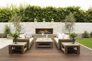 contemporary outdoor spaces vertical white fence outdoor fireplace in the wall clean