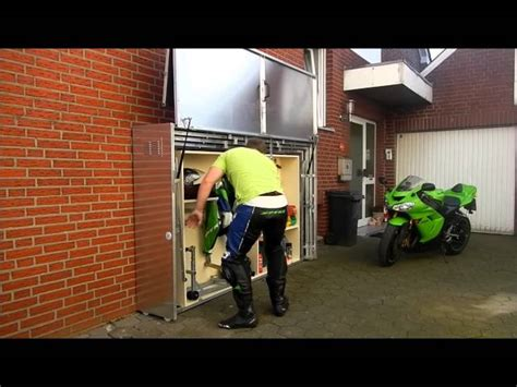 retractable motorcycle shed  awesomer
