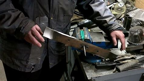 how to sharpen a lawnmower blade with a bench grinder how to sharpen and balance a lawn mower blade youtube