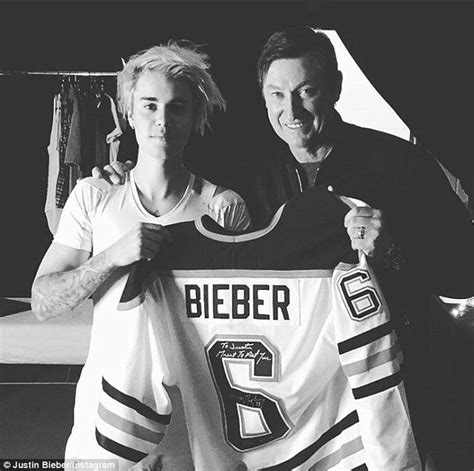 justin bieber shows off his canadian homegrown ice hockey
