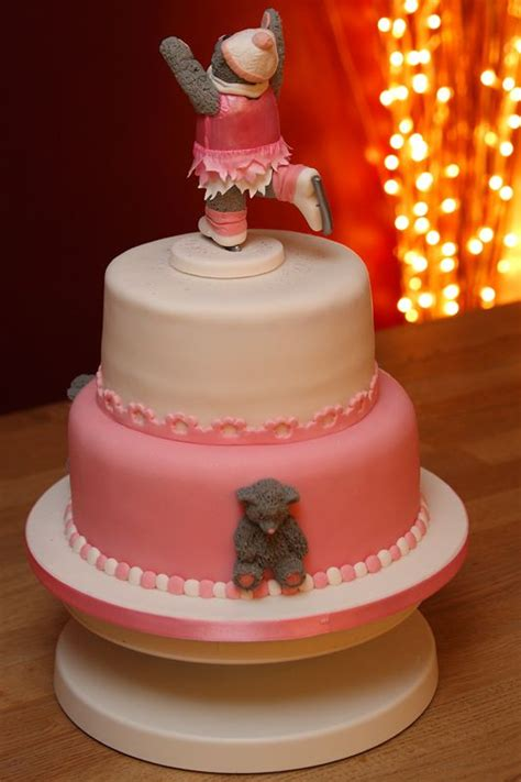 Handcrafted Cakes - two tier cake with handmade fondant skating topper