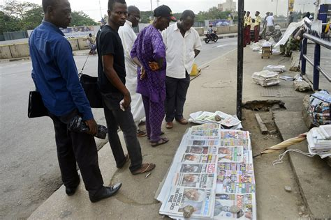 death men in nigeria people in nigeria gathered in lagos surveying a series of