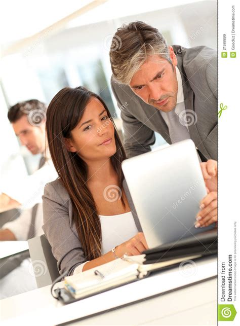 Desk Asisten Manager by Manager And Assistant In Office Royalty Free Stock Images