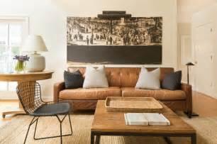 color scheme caramel color fiber rug rustic coffee table warm neutral wall