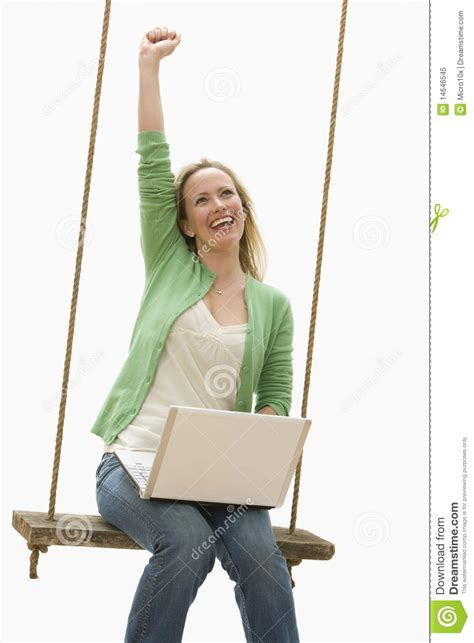 swing woman young woman on a swing using a laptop royalty free stock