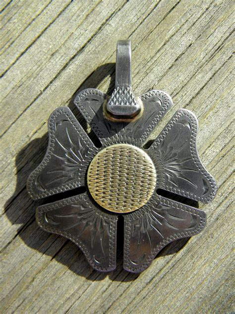 handmade jd moss spur rowel pendant clover rowel