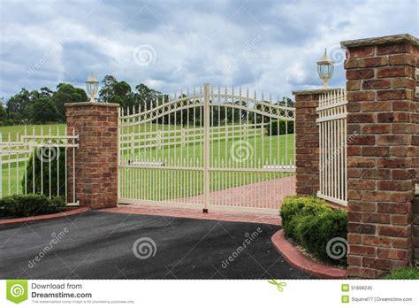 wrought iron fence lighting white wrought iron driveway entrance gates stock photo