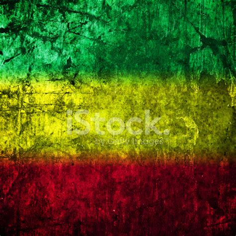 red, yellow, green rasta flag on concrete wall stock