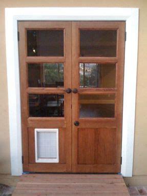 hand  custom french doors  dog door  glerup