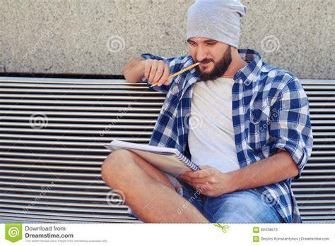 bench manly thoughtful stylish man sitting on bench stock image